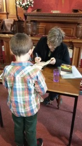 Angie Sage signing books